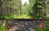 Banvallen ut ur Fryksta korsar järnvägen till Kil 2013-06-21