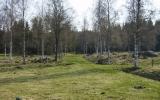 Gräsbevuxen banvall vid Backens gård mellan Ubbared och Strängsered 2011-04-23